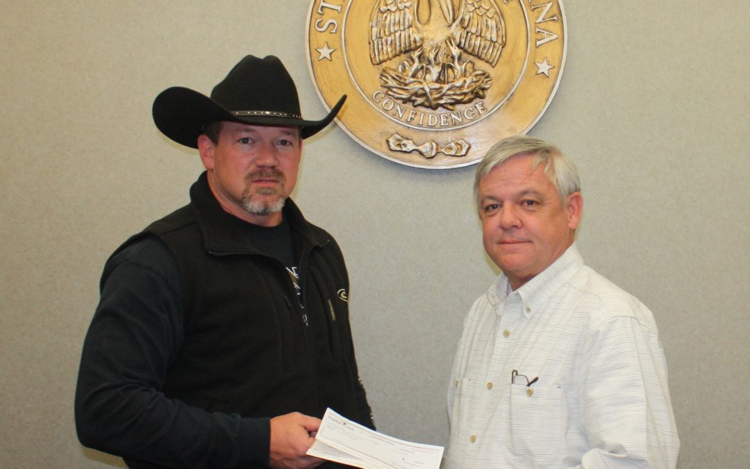 DA Marvin presents a $10,000 check to Louisiana State Police